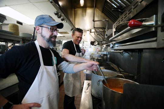 Jay Kwiecinski of Ocean Grove and Richard Schlossbach, co-owner of Langosta Lounge, prepare soup before the annual Christmas Community Dinner at Langosta Lounge in Asbury Park, NJ Tuesday, December 25, 2018.