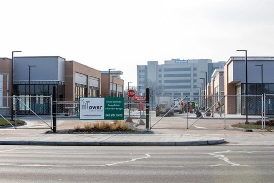 Beaumont Health System is rebuilding the landmark shopping center that for more than half a century occupied the land adjacent to it, to be called Woodward Corners on the southwest corner of 13 Mile and Woodward in Royal Oak, Thursday, Dec, 13, 2018. The hospital is in the background.