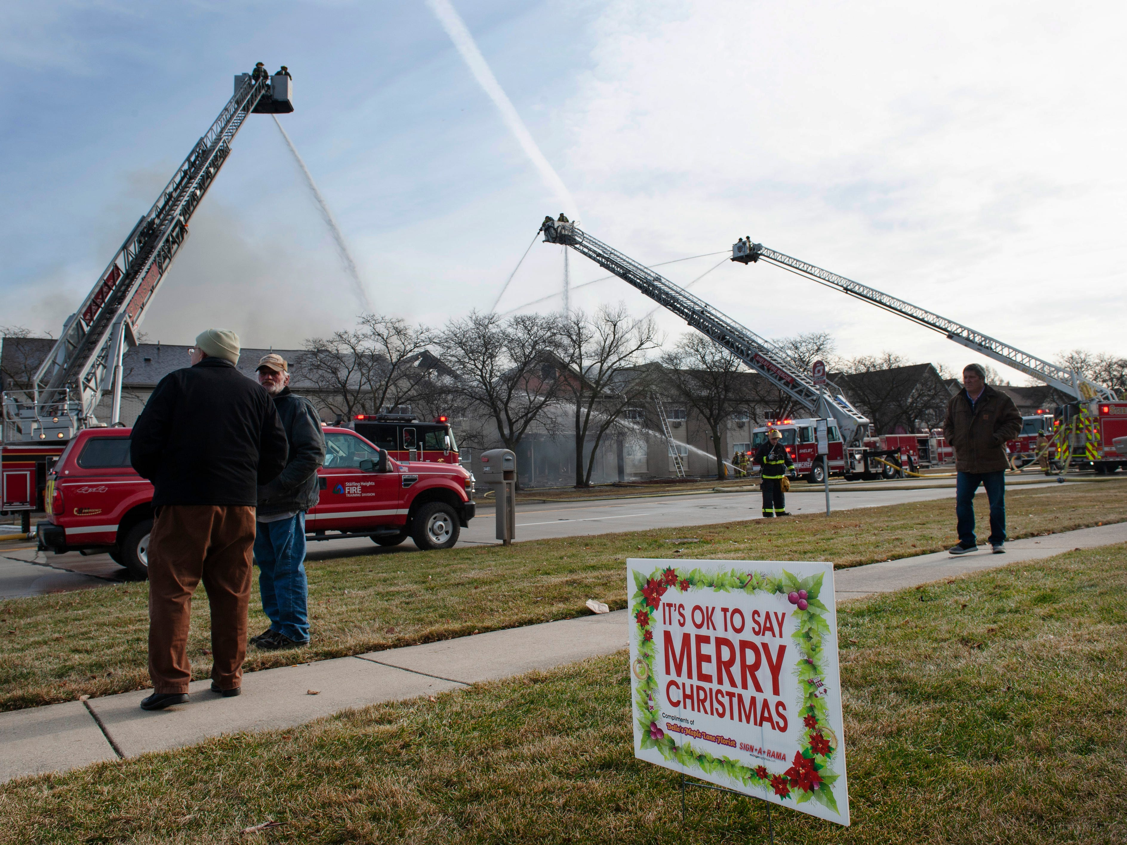 A lawn sign across Dequindre Road from the fire scene at the Sterling Troy Apartments reminds all that it is Christmas Day in Sterling Heights.