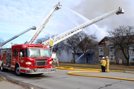 Firefighters from Sterling Heights, Shelby Township, Clinton Township and Warren worked to put out a blaze at the Sterling Troy apartment complex on Christmas morning, 2018
