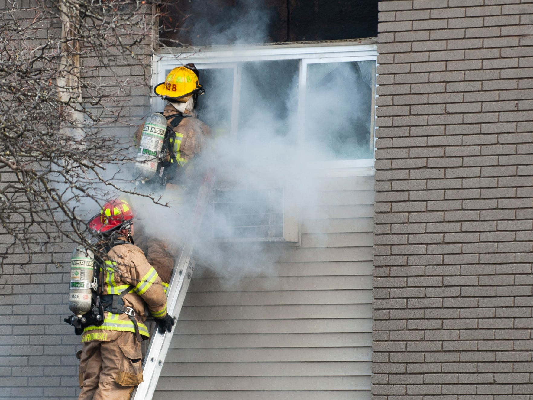 Firefighters douse a huge fire on Christmas morning at the Sterling Troy Apartments.