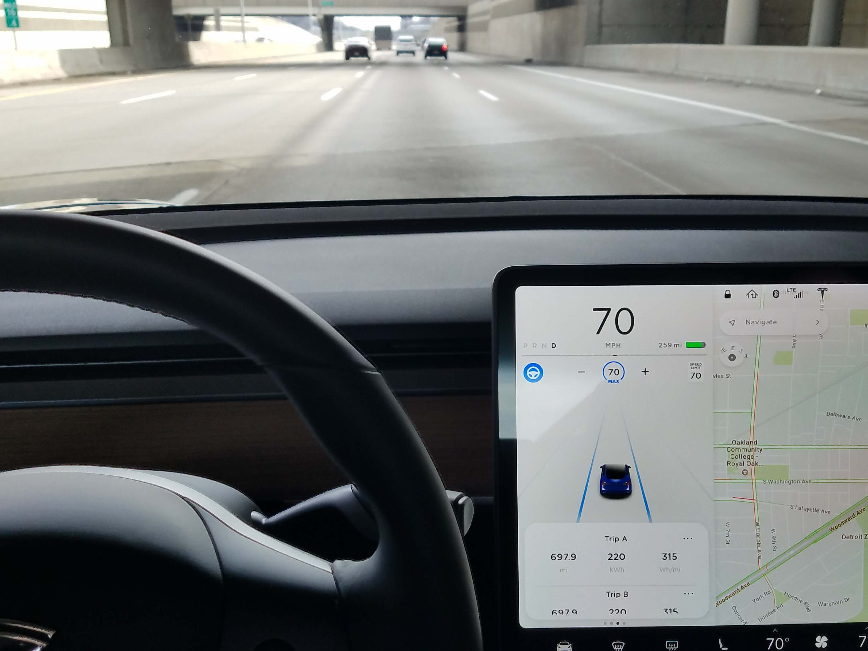 Self-driving Auto Pilot comes as an option of the Tesla Model 3. Push the steering wheel button on the northwest corner of the display, it turns blue, and the car takes over.