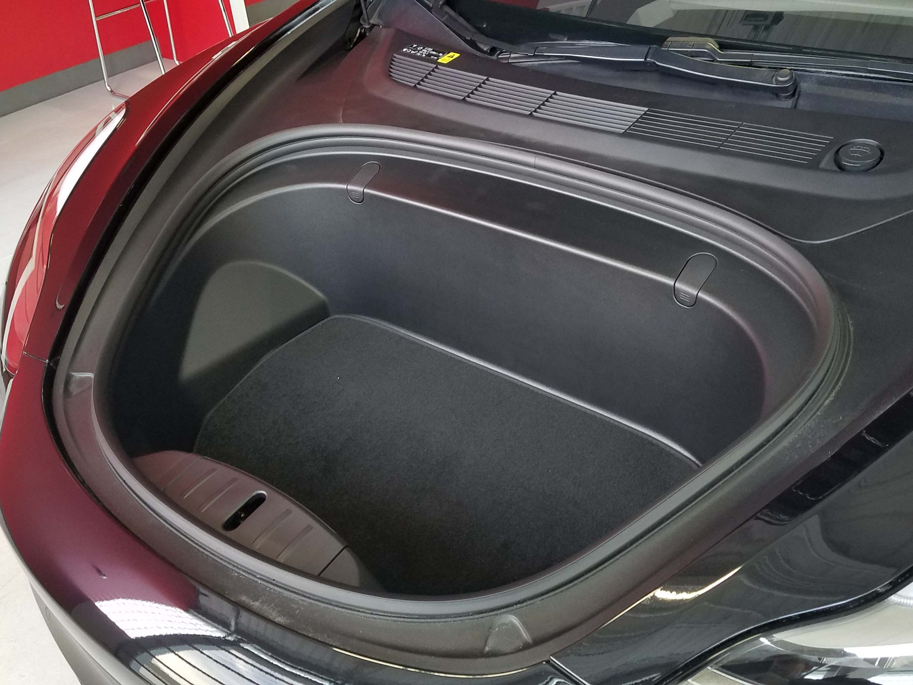 "Without an engine in front, the electric Tesla Model 3 features a ""frunk"" for added storage."