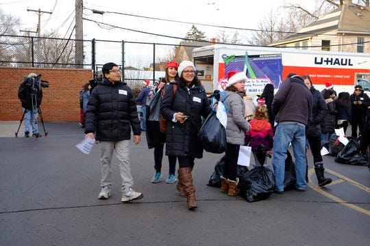 Congresswoman-elect Rashida Tlaib and her son Adam join Mitzvah Day giving back to southwest Detroit and the neighborhood she grew up in.