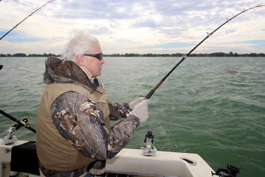 Lynn Henning waits for a muskie strike on a windy day on Lake St. Clair.