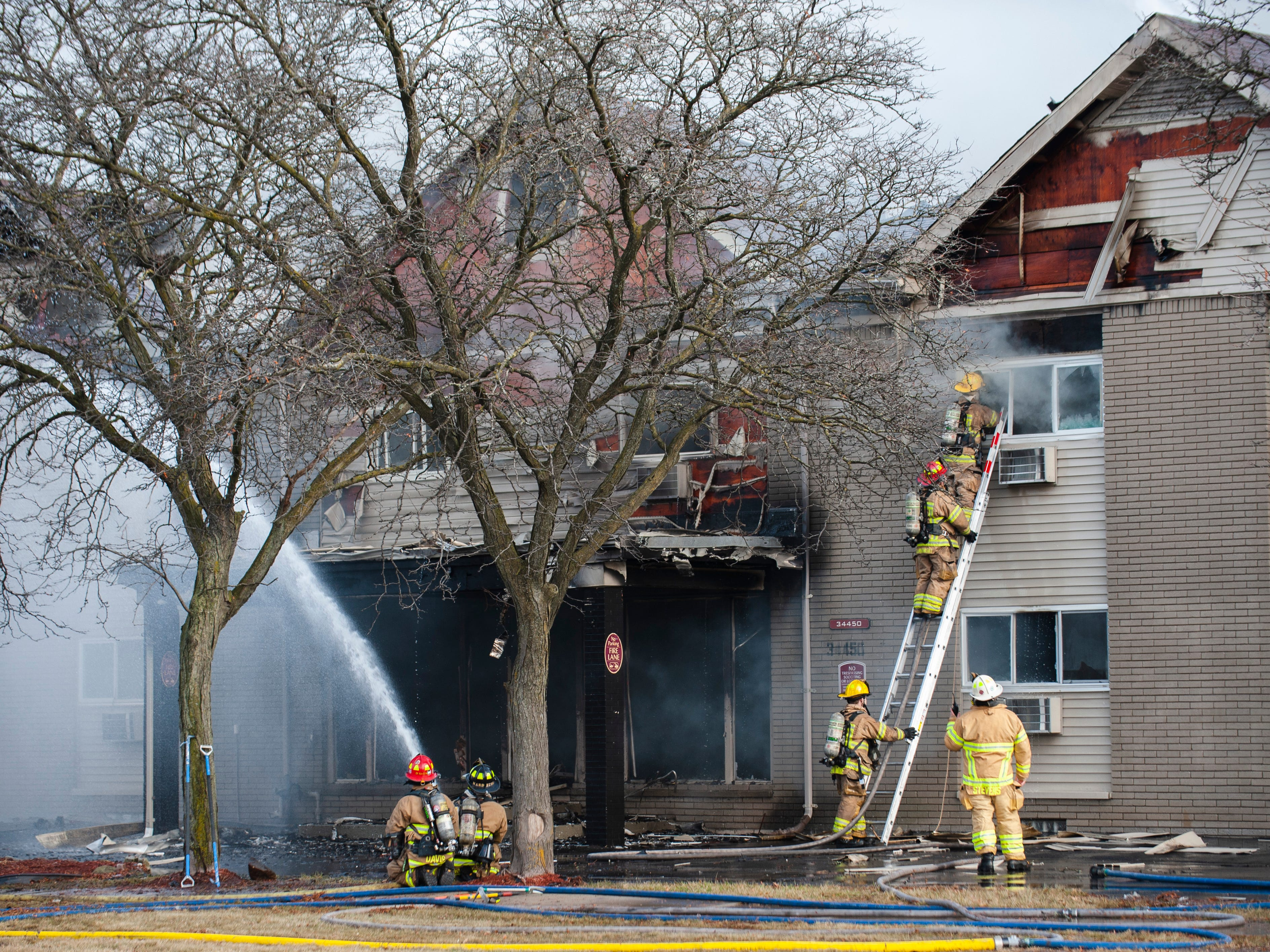 Firefighters douse a huge fire on Christmas morning at the Sterling Troy Apartments in the 34400 block of Dequindre near 15 Mile Rd. in Sterling Heights.