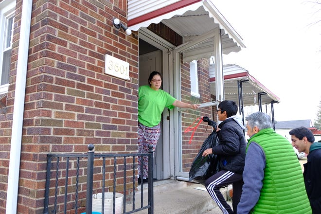 Volunteers delivered gifts to homes of families found through local nonprofits and churches.