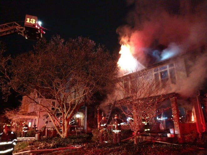 """Indianapolis firefighters battle a fire on the 1400 block of North Alabama Street around 3:30 a.m. on Christmas morning. No one was injured, but officials said the home was a """"total loss,"""" including the two children's Christmas gifts."""