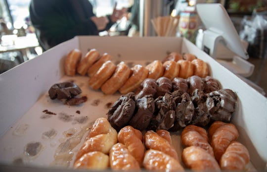 A few of the free 450 doughnuts being given out at Neidhammer Coffee Co. on Tuesday for people who could use a treat on Christmas Day.