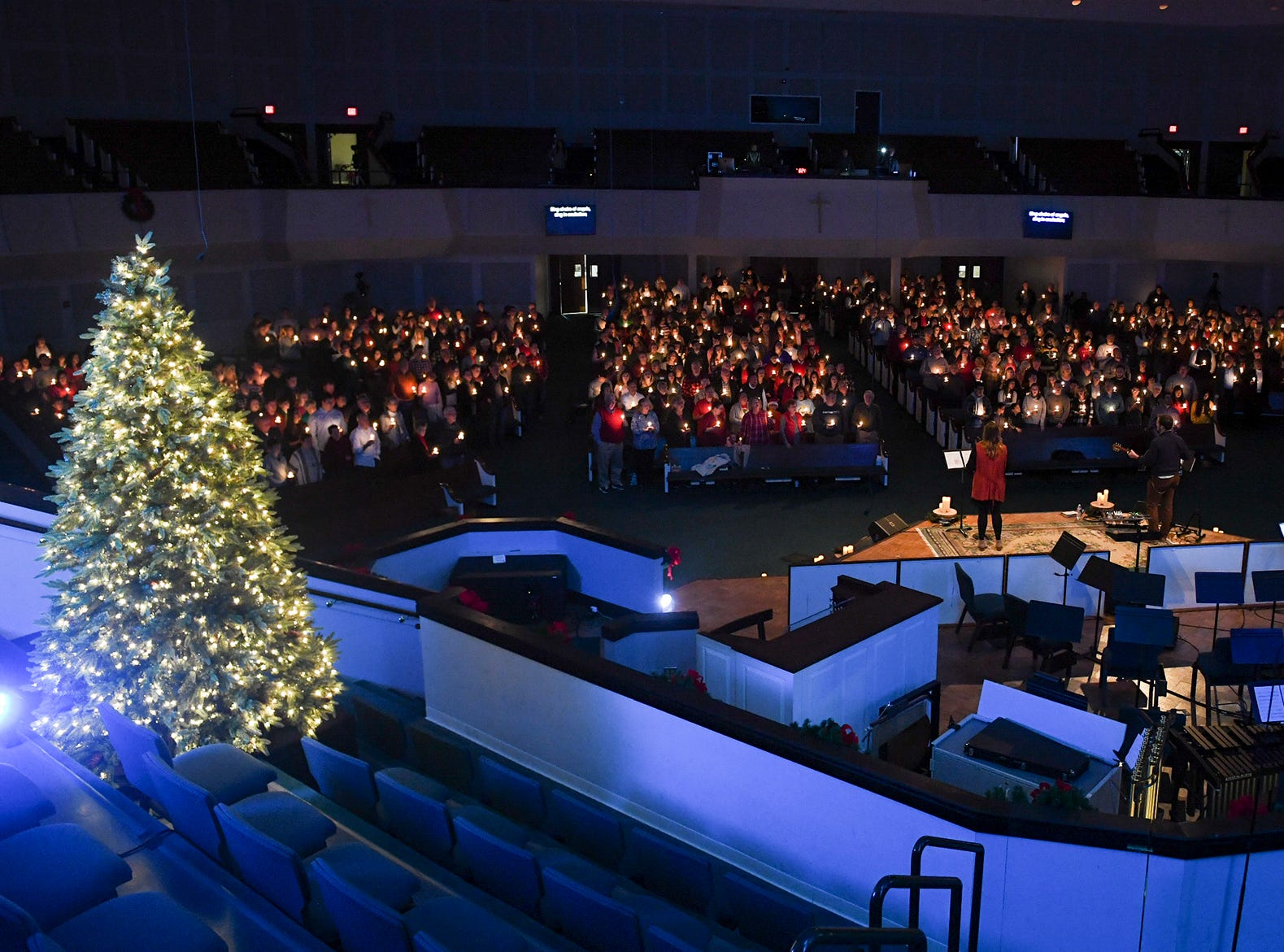 Members of the congregation at West Jackson Baptist Church hold up candles during the singing of Silent Night at Christmas Eve at West Jackson, Monday, Dec. 24.