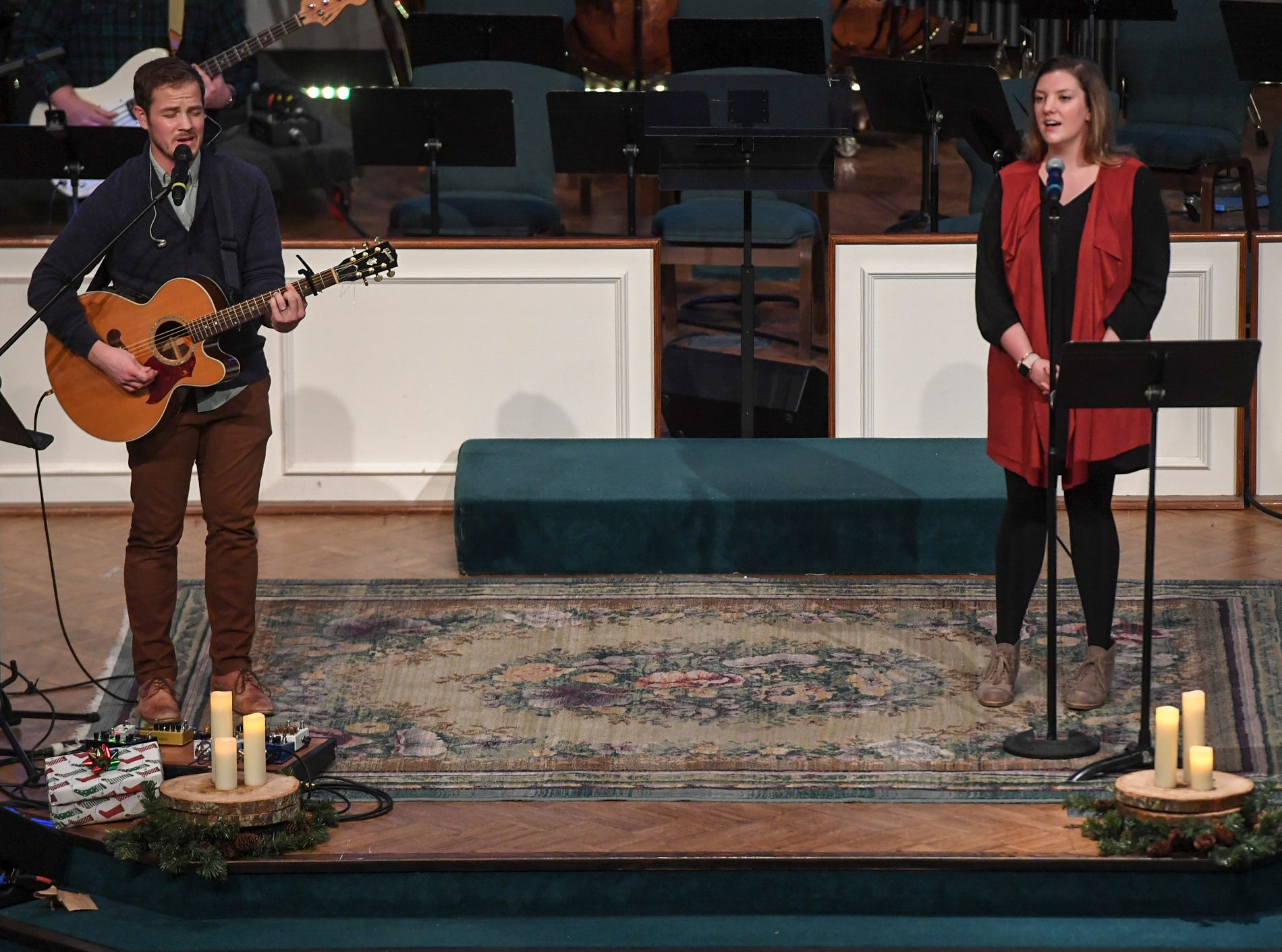 Paul Helms and Nicole Camp sing Joy to the World during Christmas Eve at West Jackson, Monday, December 24.
