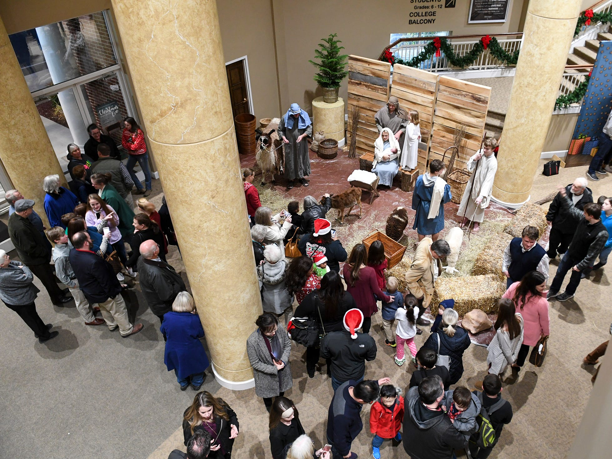 Guest gather at the entrance of West Jackson Baptist Church to view the live Nativity scene during Christmas Eve at West Jackson, Monday, December 24.