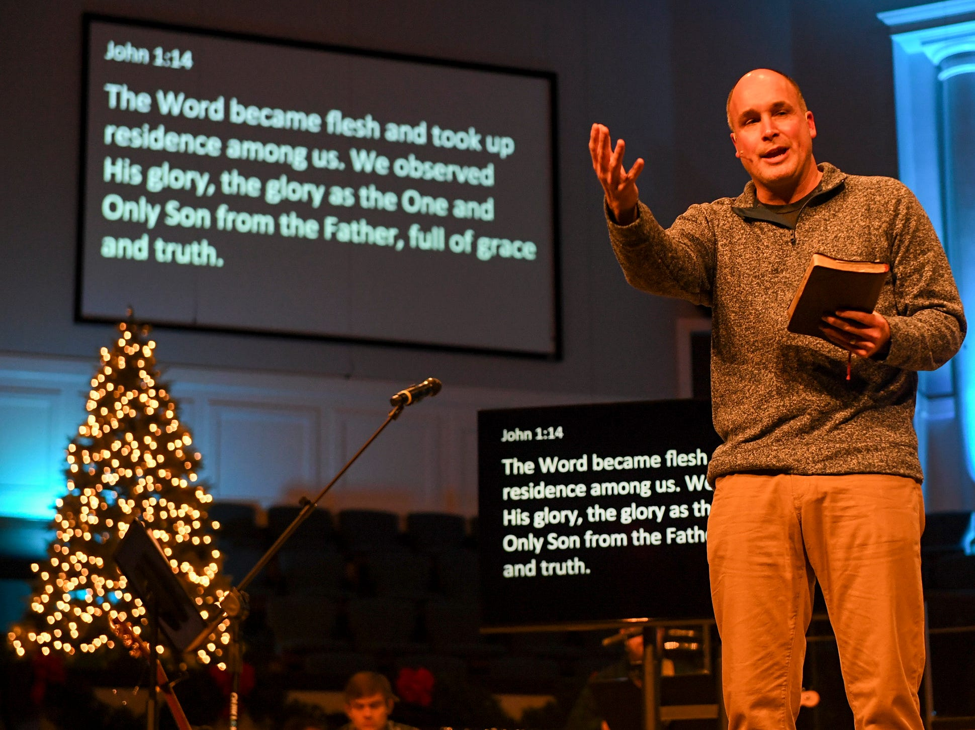 West Jackson Baptist Church Pastor Andy Neely preaches to a congregation at West Jackson during Christmas Eve at West Jackson service, Monday, Dec. 24.