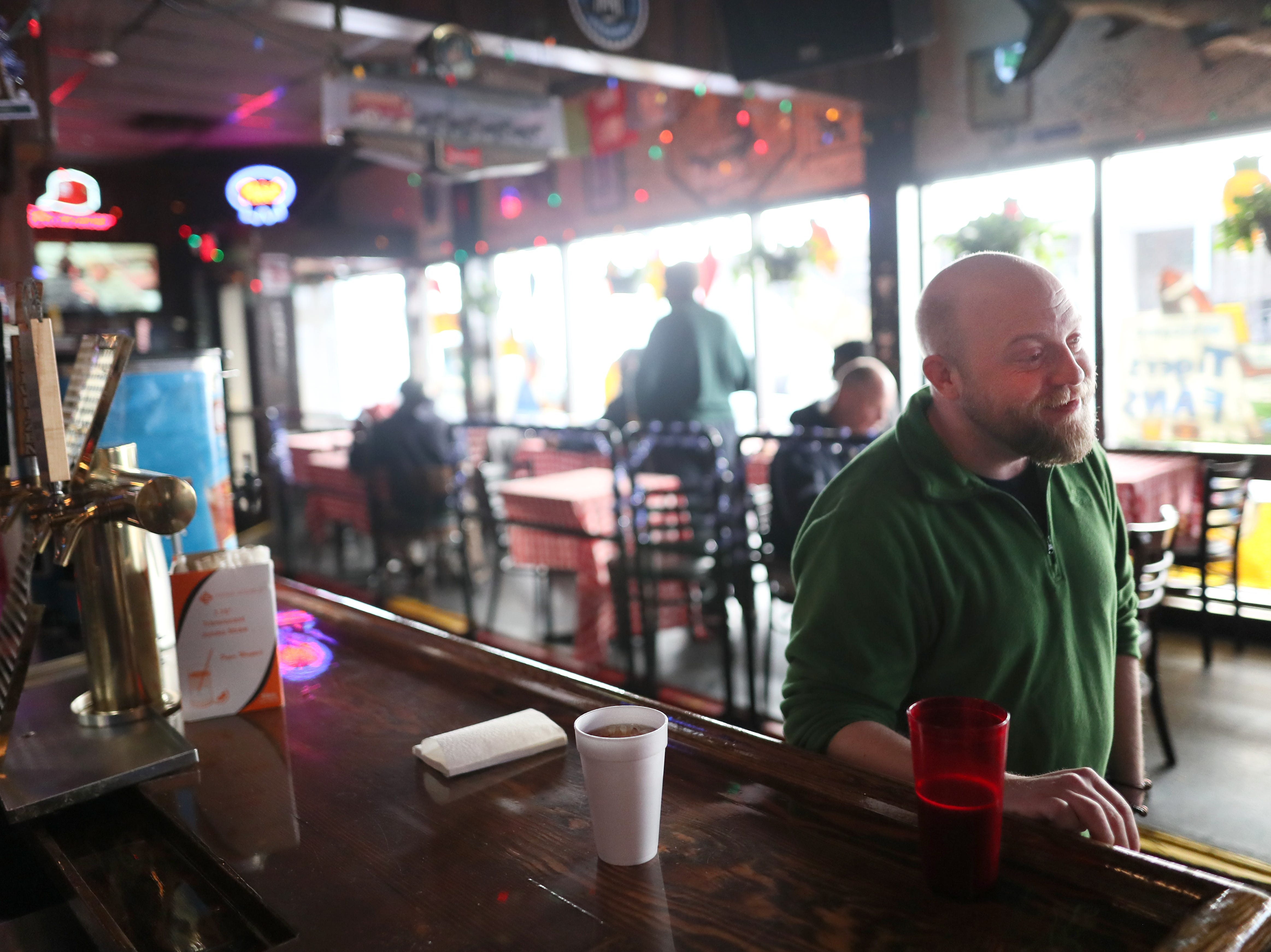 Assistant Manager J.P. Townsend opens up Huey's downtown restaurant on Christmas Day to serve free meals and hand out warm clothing Tuesday, Dec. 25, 2018.