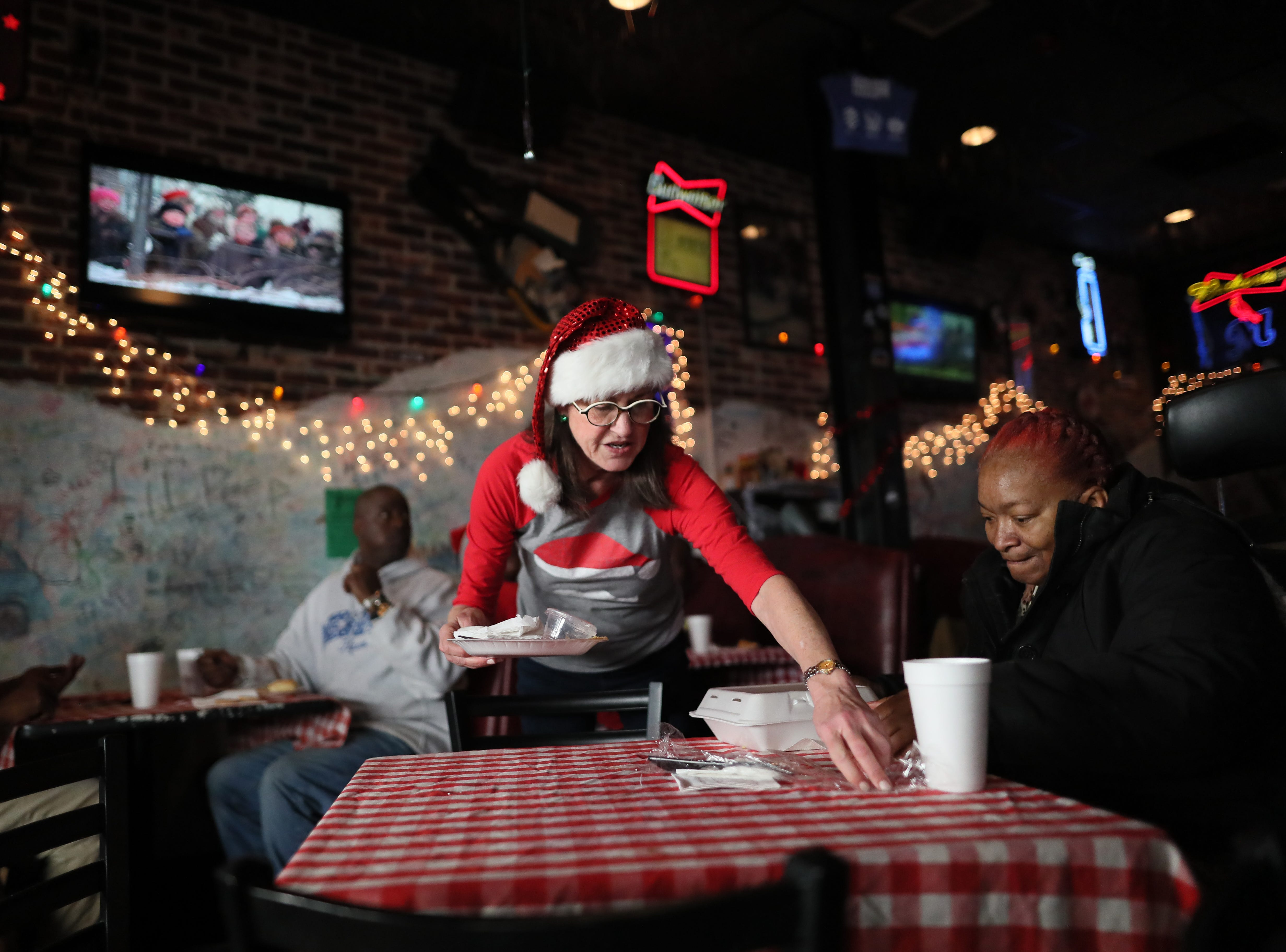 Owner Wight Boggs opens up Huey's Downtown restaurant on Christmas Day to serve free meals and hand out warm clothing Tuesday, Dec. 25, 2018.