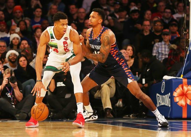 Bucks forward Giannis Antetokounmpo works against the defense of the Knicks' Lance Thomas on Tuesday at Madison Square Garden.