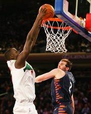 Bucks forward Thon Maker dunks against Knicks forward Luke Kornet  during the second half Tuesday.