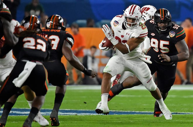Jonathan Taylor rushed for 130 yards in UW's 34-24 victory over Miami in the 2017 Orange Bowl.