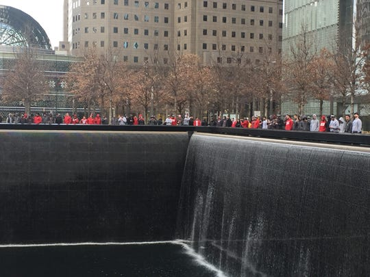 Wisconsin football players tour the memorial at the site of 9/11 World Trade Center attack.