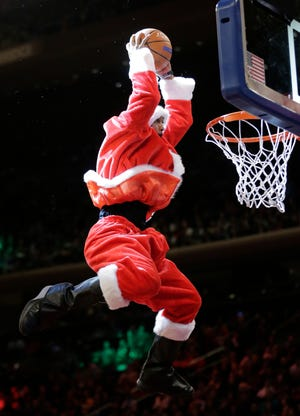 A cardboard cutout of  Santa would be a slam dunk choice when the Milwaukee Bucks host the Golden State Warriors on Christmas Day.