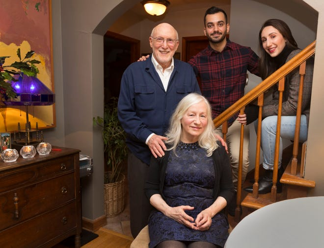 "Taif Jany (back center) is shown with his girlfriend, Carrie Hopper (right), along with her parents, Myles and Catherine Hopper, on Tuesday. At the Hoppers' Shorewood home, ""there is always room at the inn."""
