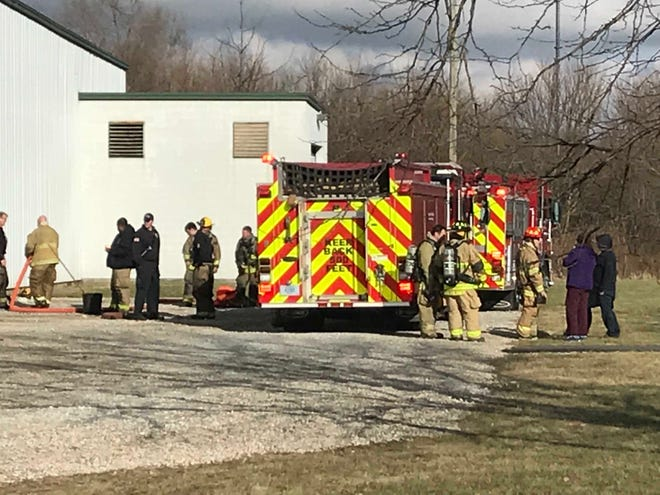 Muncie firefighters at the scene of a Christmas Day fire at a plant in the southside Industria Centre.