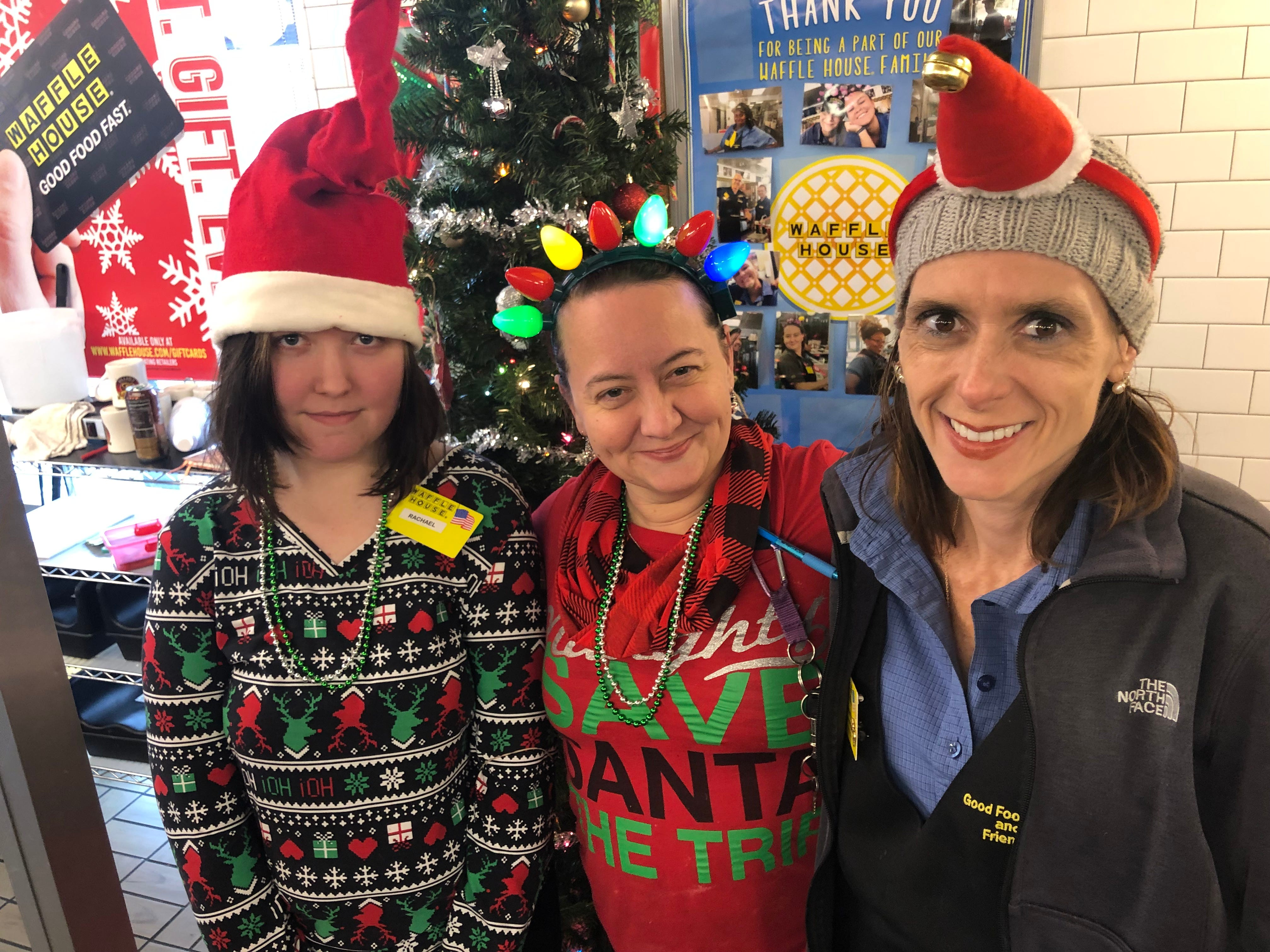"Waffle House employees in their new silly Christmas hats they got Christmas morning 2018 from ""Santa"" George Armistead"