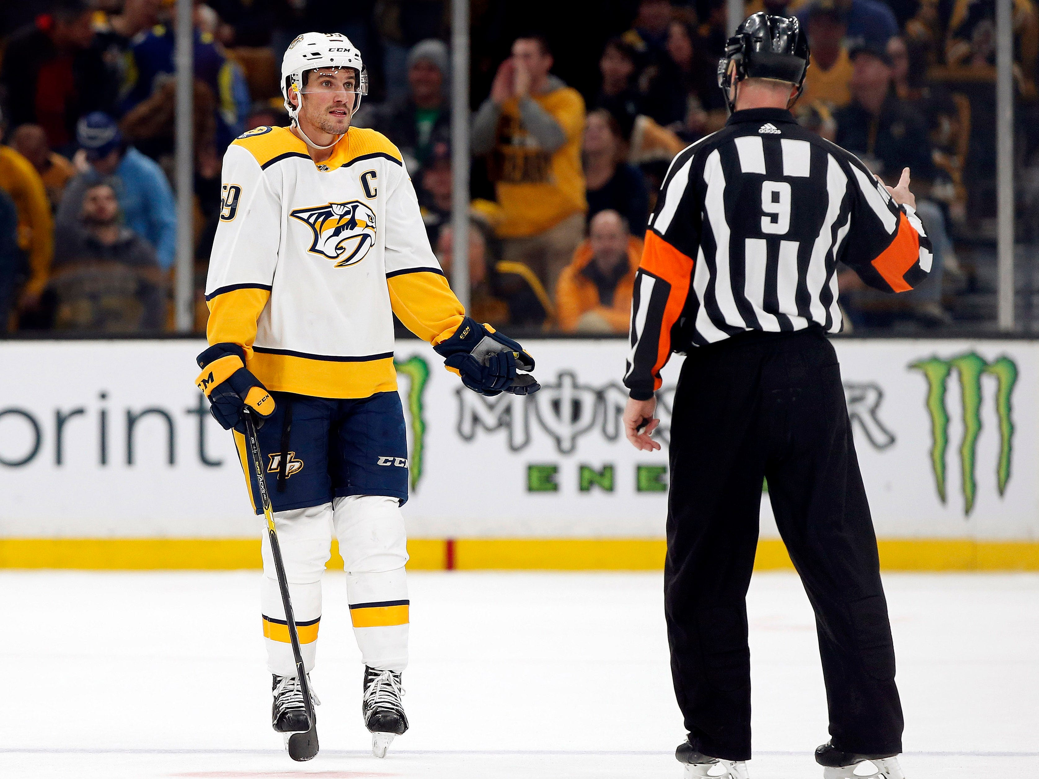 Nashville Predators defenseman Roman Josi (59) reacts to being called for a penalty by referee Dan O'Rourke (9) during the third period of their 5-2 loss to the Boston Bruins at TD Garden.
