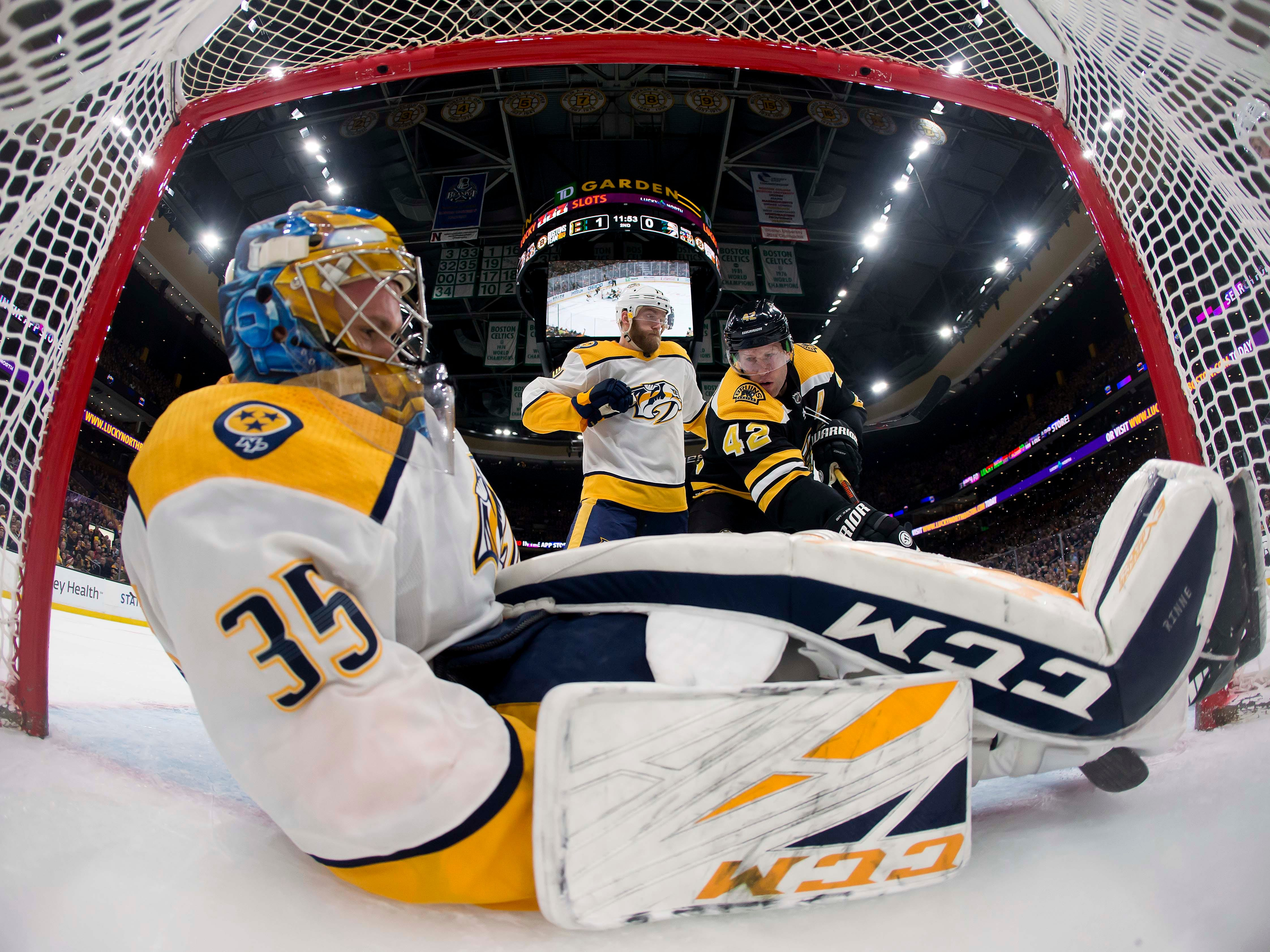 Dec 22: Bruins 5, Predators 2 -- Boston Bruins right wing David Backes (42) can't stuff the puck past Nashville Predators goaltender Pekka Rinne (35) during the second period at TD Garden.