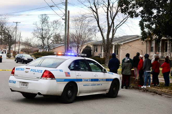 Metro Nashville Police work the scene of a Christmas Day shooting on Creekview Drive in Nashville, Tenn.