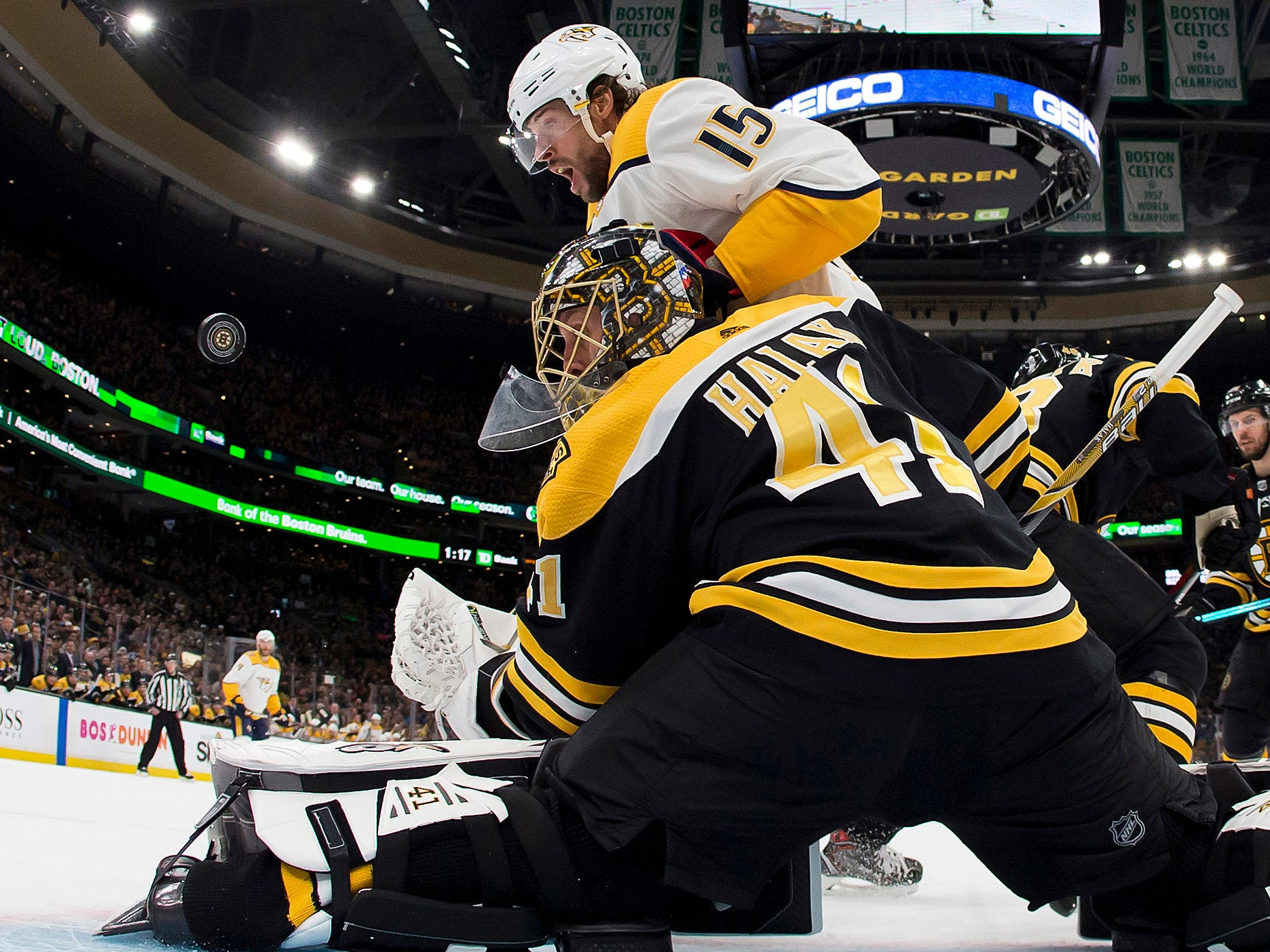 Nashville Predators right wing Craig Smith (15) eyes a rebound off a save by Boston Bruins goaltender Jaroslav Halak (41) during the first period of Boston's 5-2 win at TD Garden.