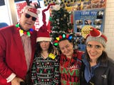 Nashville Kiwanis exec and former Metro Councilman brings neighbors to sing and give out goofy hats and candies to employees and custumers