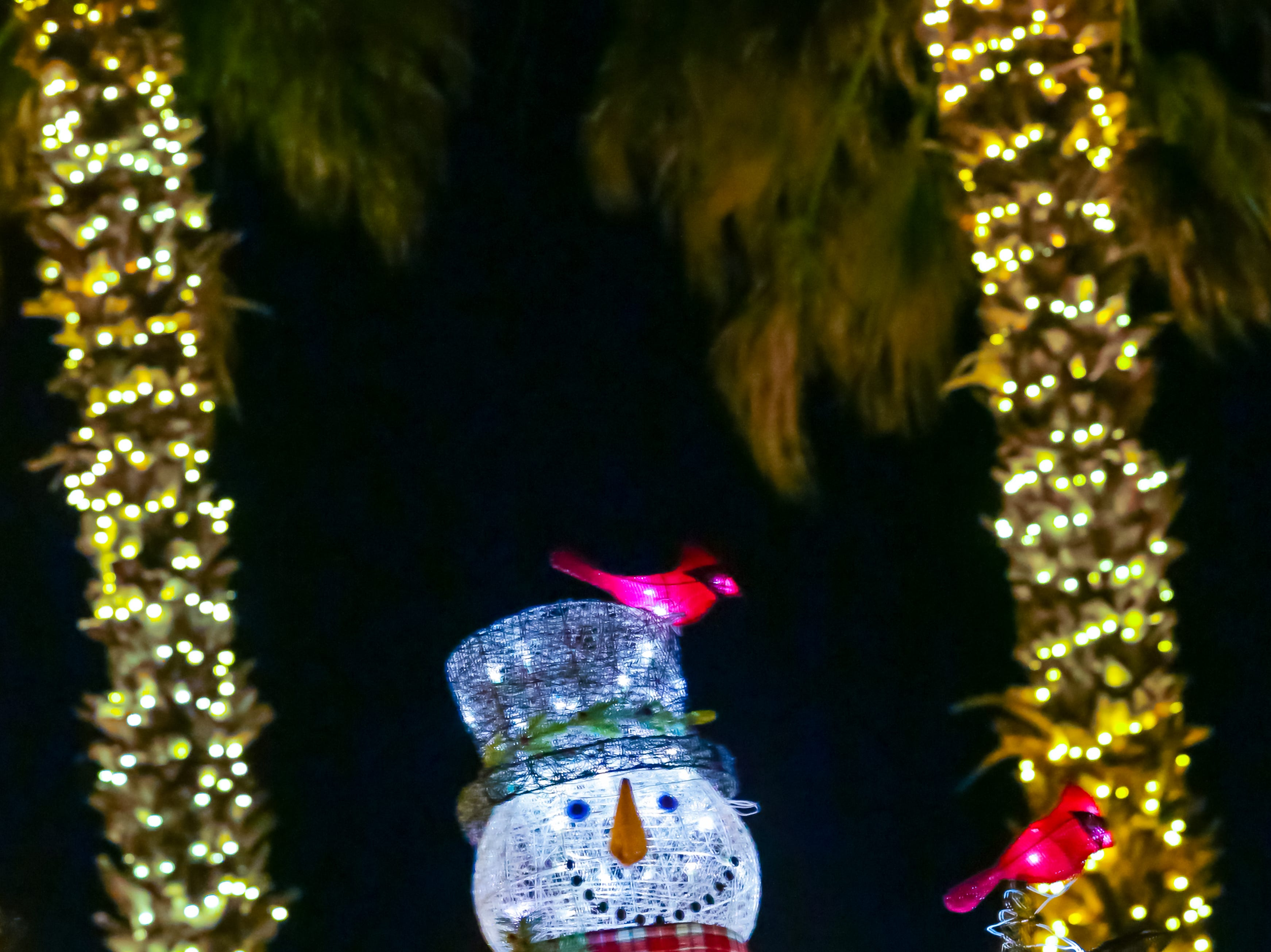 A glowing snowman is pictured at the Mesilla Plaza on Christmas Eve, Monday, Dec. 24, 2018.