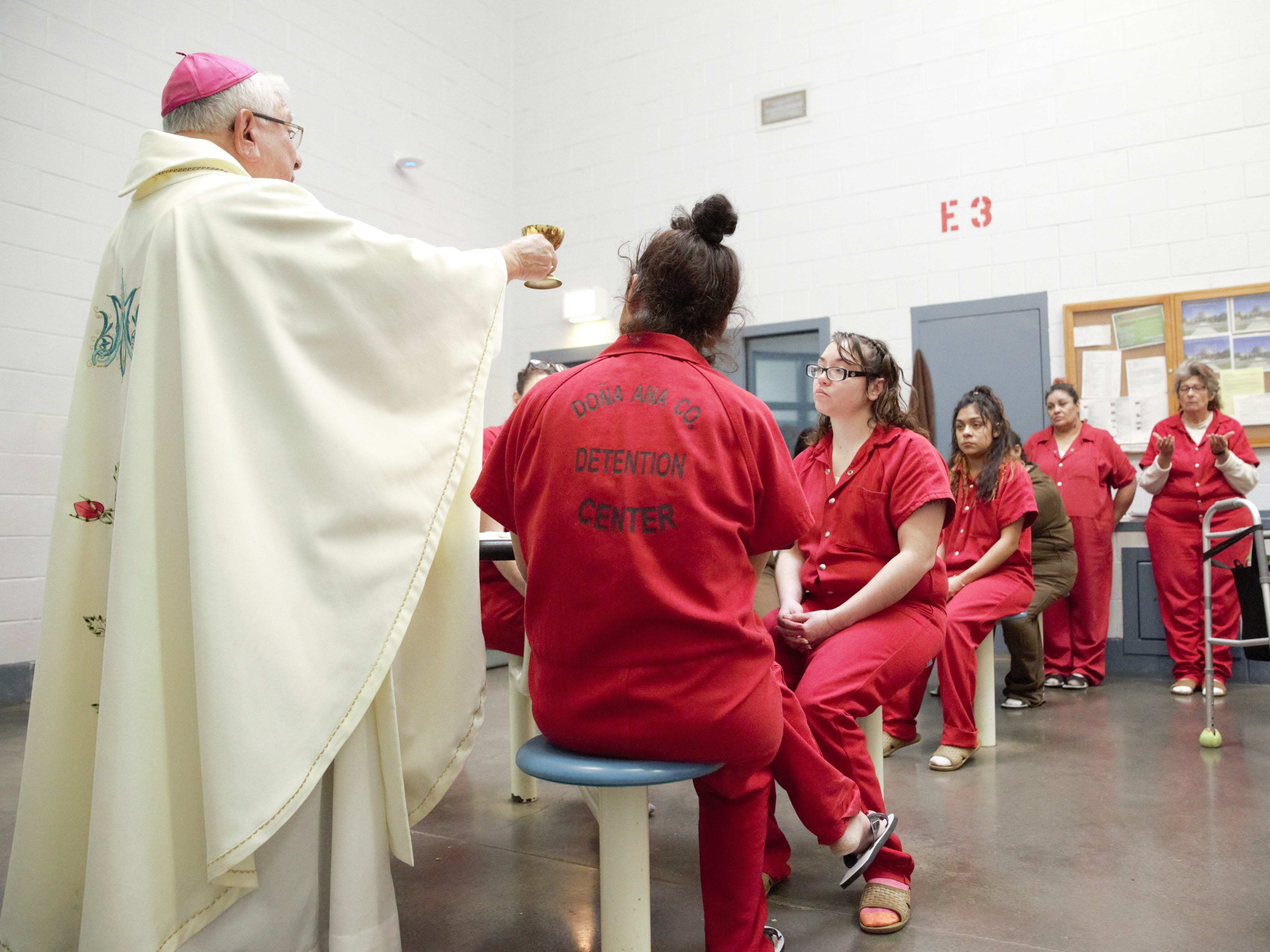 Bishop Emeritus Ricardo Ramírez of the Catholic Diocese of Las Cruces hosts a communion ritual on Tuesday, Dec. 25, 2018, with a group of women inmates during a special Christmas Mass inside the Doña Ana County Detention Center.
