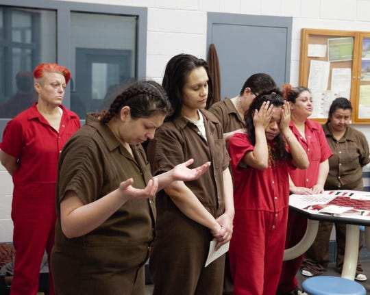 Inmates at the Doña Ana County Detention Center pray during a special Christmas Mass hosted by volunteers and clergy at the facility on Dec. 25, 2018.