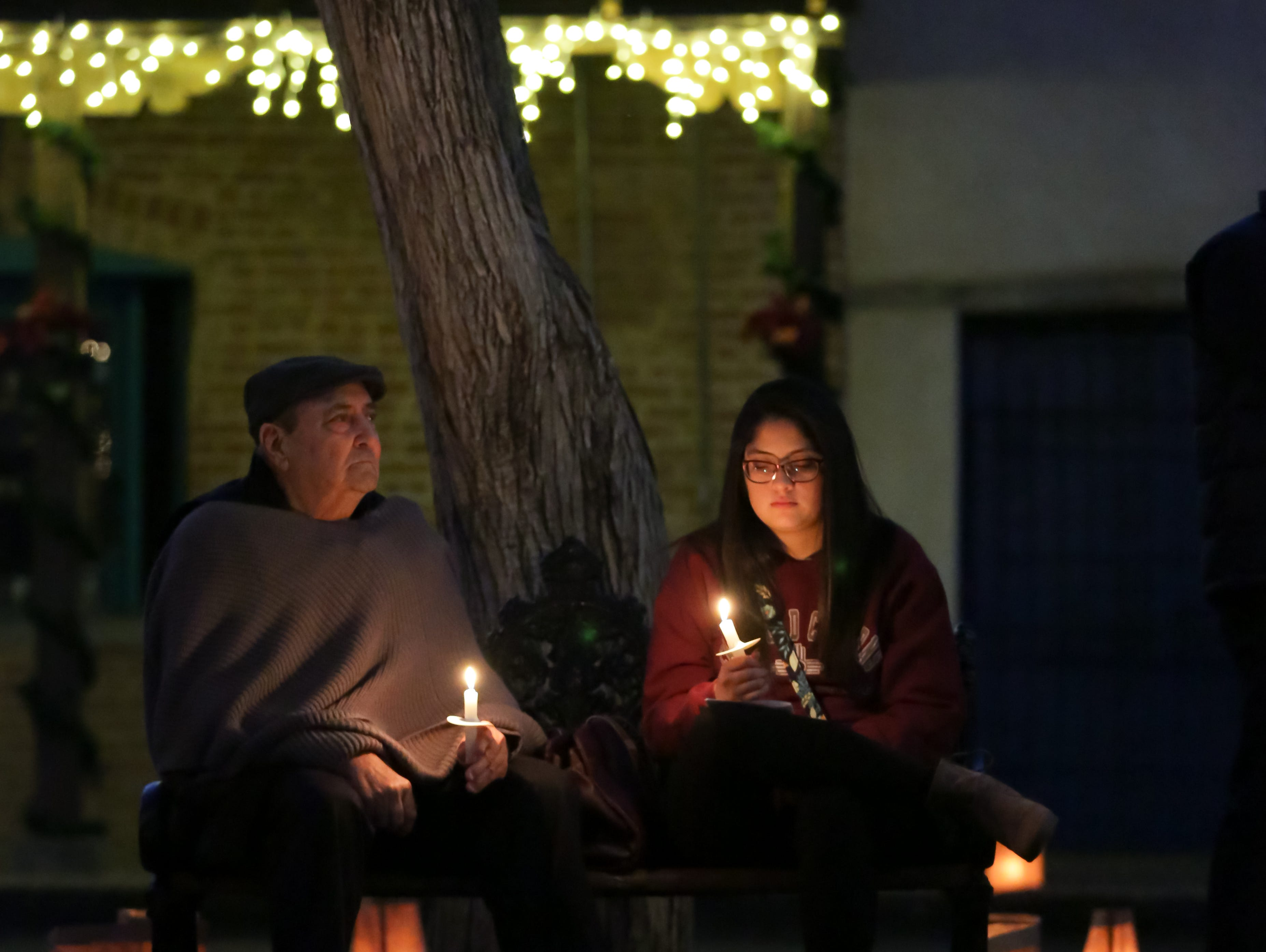 Ramon Martinez, and his granddaughter Sophia Villegas check out the festivities at the Mesilla Plaza on Christmas Eve, Monday, Dec. 24, 2018. There were 6,000 luminarias lit by the historic village of Old Mesilla.