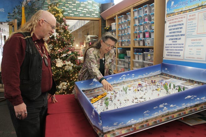 CAPPED volunteer Troy Bentley and Executive Director Tresa Van Winkle examine a model of the Trinity Turtle Labyrinth Park.