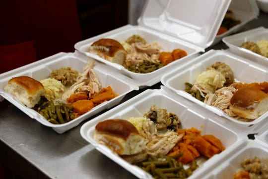 Volunteers at the Aztec Senior-Community Center spent part of Christmas preparing meals to be delivered to Aztec residents on Tuesday.
