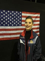 Caroline Julian proudly stands in front of the U.S. flag following the tap dance worlds Dec. 1 in Germany.