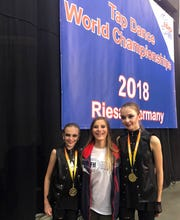 Team USA members Caroline Julian (center) with junior gold medalists Olivia Steele and Alisa Zharonkova of Northville.