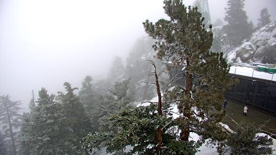 Snow falls atop Mount San Jacinto on Christmas morning.