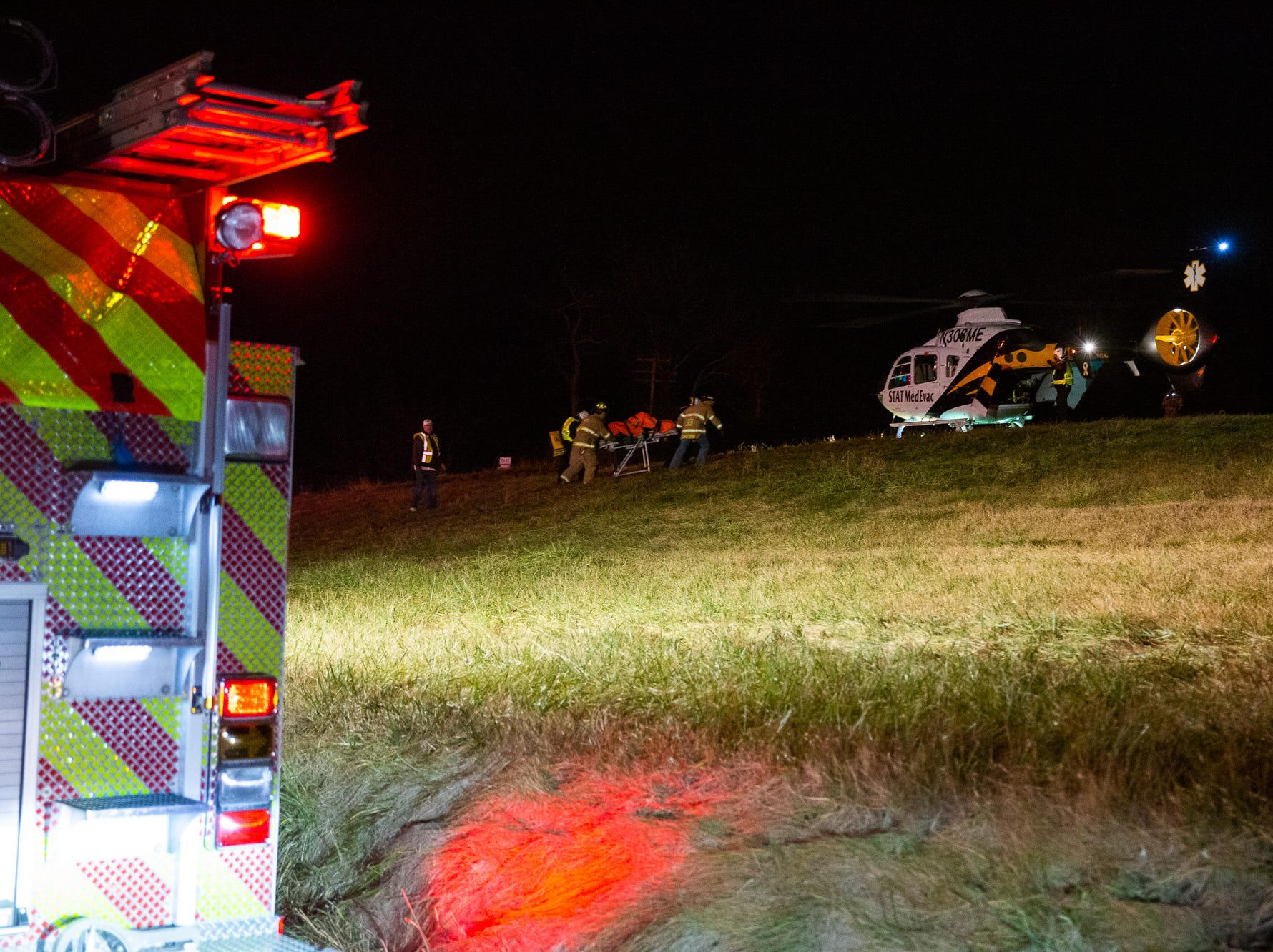 Crews transport a patient to a waiting medical helicopter at the scene of a crash on the 2200 block of East Berlin Road on Monday, Dec. 24, 2018, in Reading Township. Hampton Fire Chief P.J. Trimmer said two people were flown to York Hospital.