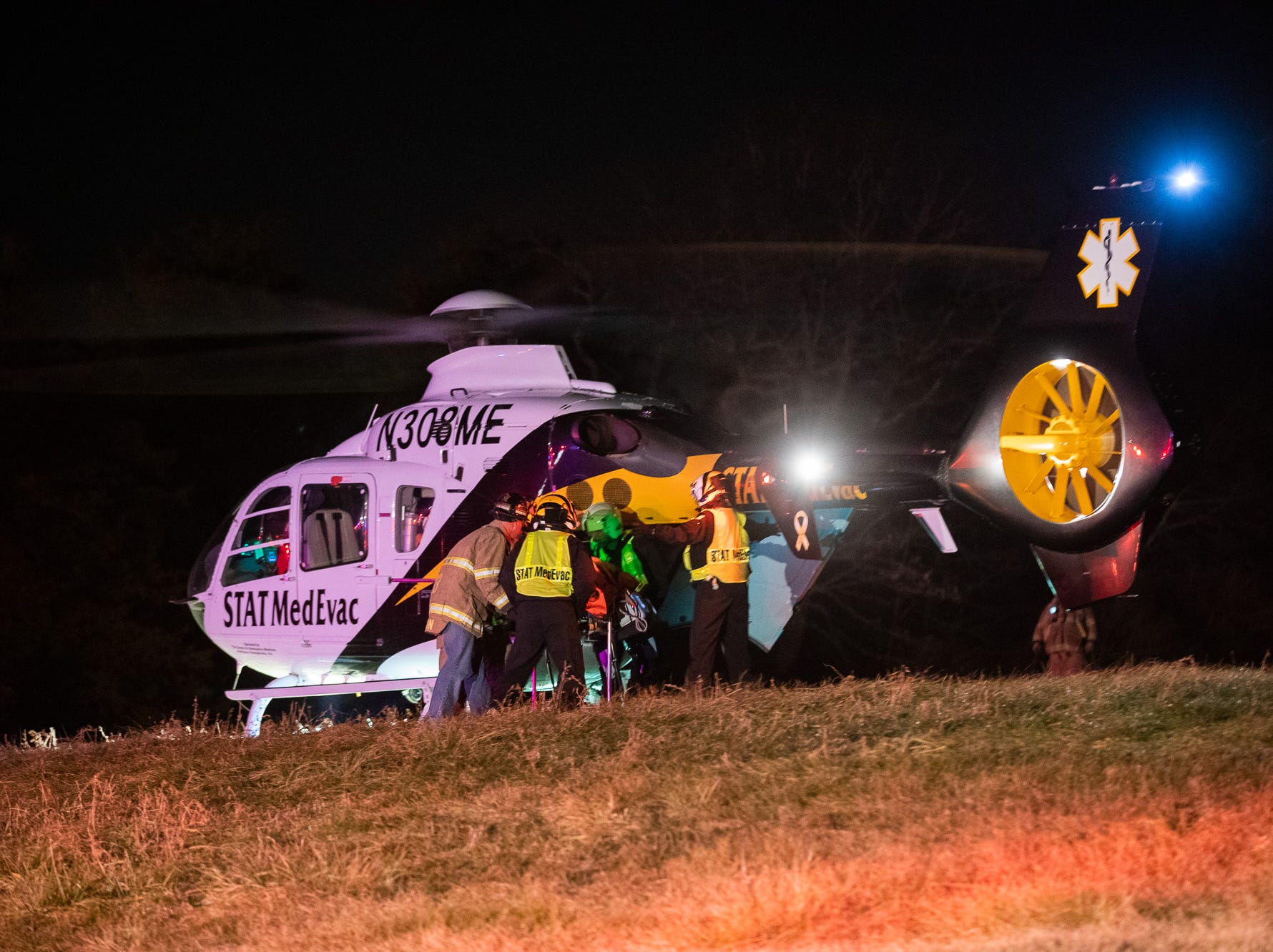 Crews transport a patient to a waiting medical helicopter at the scene of crash on the 2200 block of East Berlin Road, Monday, Dec. 24, 2018, in Reading Township.