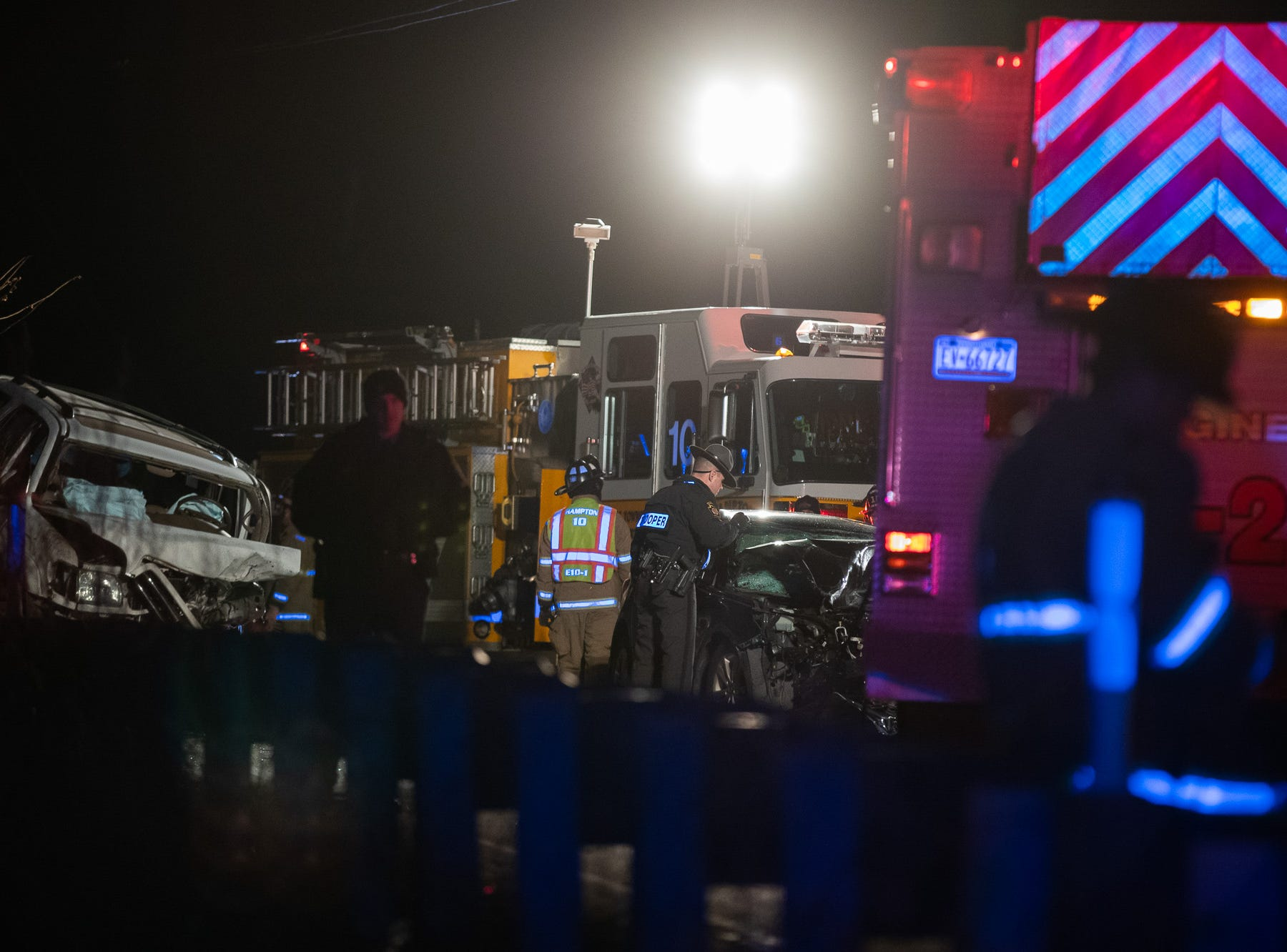 Firefighters and police work at the scene of a crash on the 2200 block of East Berlin Road, Monday, Dec. 24, 2018, in Reading Township.