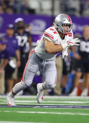 Sep 15, 2018: Ohio State Buckeyes defensive end Nick Bosa (97) rushes the passer against the Texas Christian Horned Frogs at AT&T Stadium.