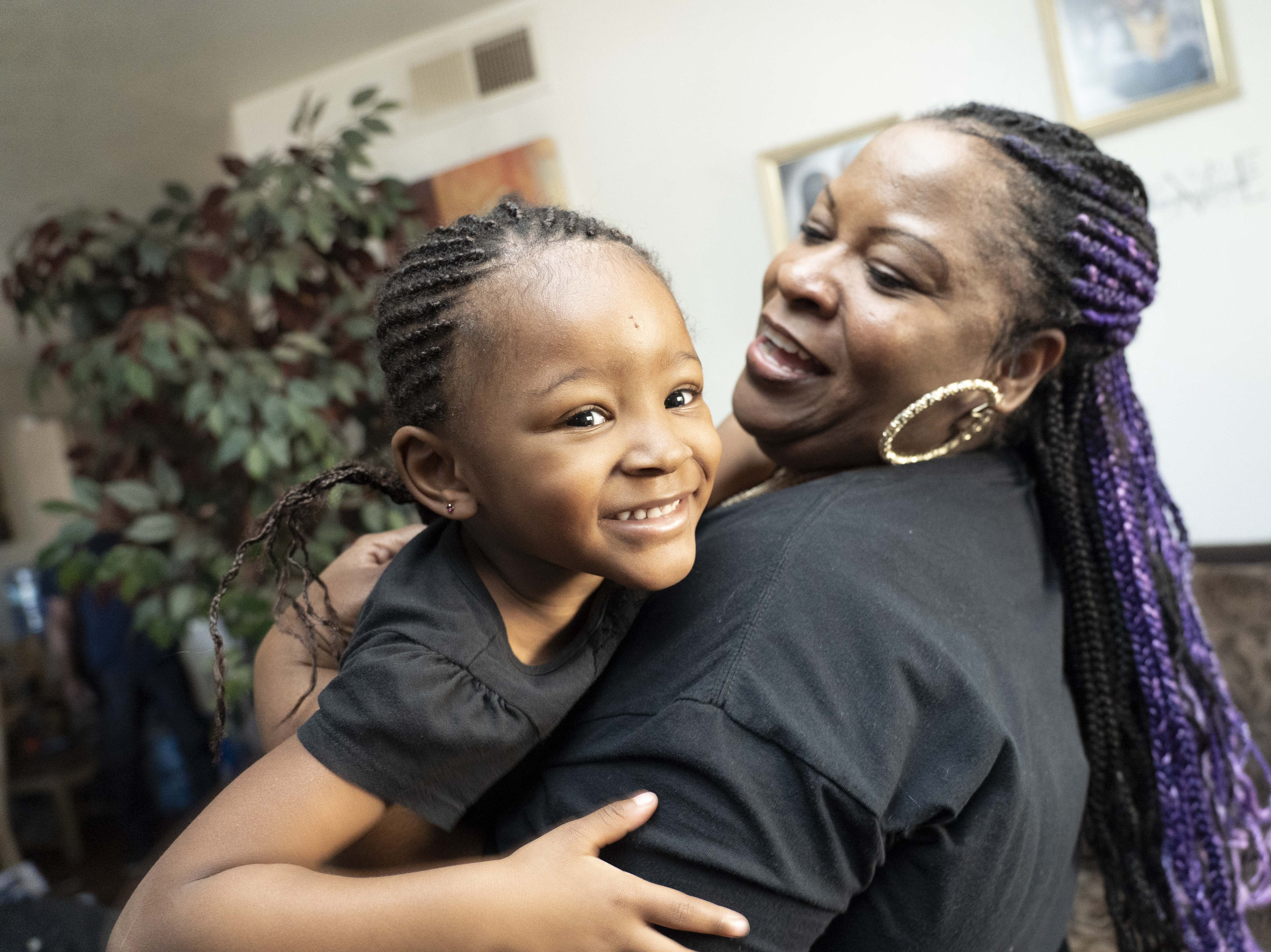 Dana Burns (right) hugs Nylayia Richards, 3. Dana Burns and the Permanent Voice Foundation, a non-profit she started n 2018 with her partner,  Jamal Carter, brought Nylayia's family, who were grieving a recent death, Christmas presents and a Christmas meal.