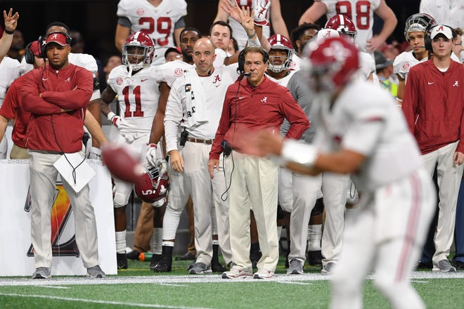 Dec 1, 2018: Alabama Crimson Tide head coach Nick Saban looks on as quarterback Jalen Hurts (2) takes a snap during the forth quarter in the SEC championship game at Mercedes-Benz Stadium.