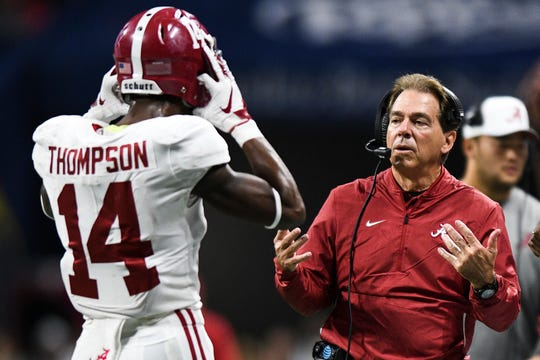 Alabama coach Nick Saban talks with defensive back Deionte Thompson (14) after a Georgia touchdown during an NCAA college football game for the Southeastern Conference championship Saturday, Dec. 1, 2018, in Atlanta. (AJ Reynolds/Athens Banner-Herald via AP)