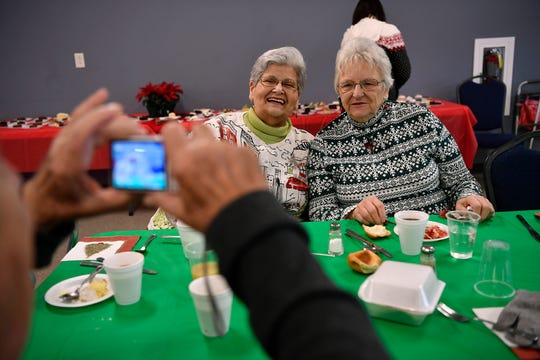Barbara Paules, left, of Dallastown and Kay Beach of York pose for a photo during the 8th annual Christmas Dinner at Bethlehem United Methodist Church in Dallastown, Tuesday, December 25, 2018.John A. Pavoncello photo