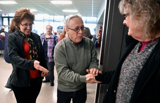 Lois and Jerry Herwig of Red Lion greet visitors of teh 8th annual Christmas Dinner at Bethlehem United Methodist Church in Dallastown, Tuesday, December 25, 2018.John A. Pavoncello photo